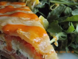 Tomato and goat cheese pie with arugula salad at the Salem Tavern.