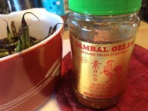 Find sambal oelek in international foods section of your supermarket.